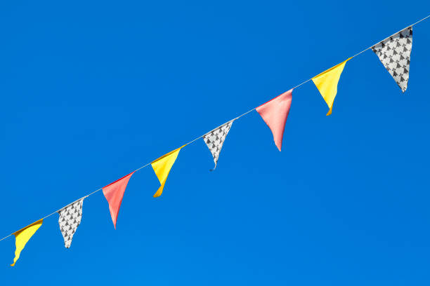 Yellow, red and ermine bunting flags stock photo
