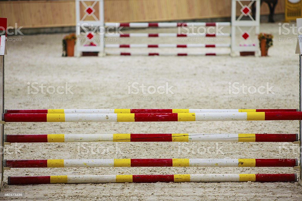 Yellow red white obstacle for jumping horses. Riding competition. stock photo
