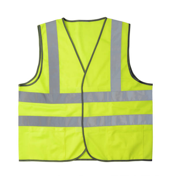 Yellow reflective vest isolated on white Yellow reflective vest isolated on white background reflective clothing stock pictures, royalty-free photos & images