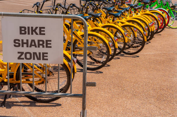 Yellow Rental bicycles sit in row in San Diego, California (P) stock photo