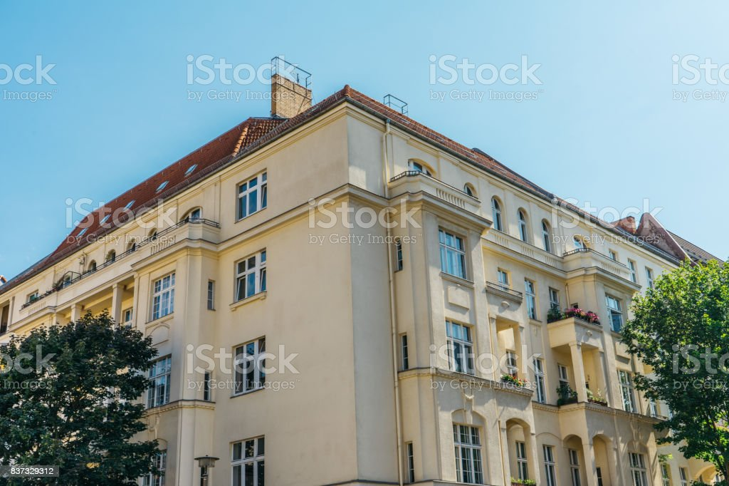 yellow residential house at berlin stock photo