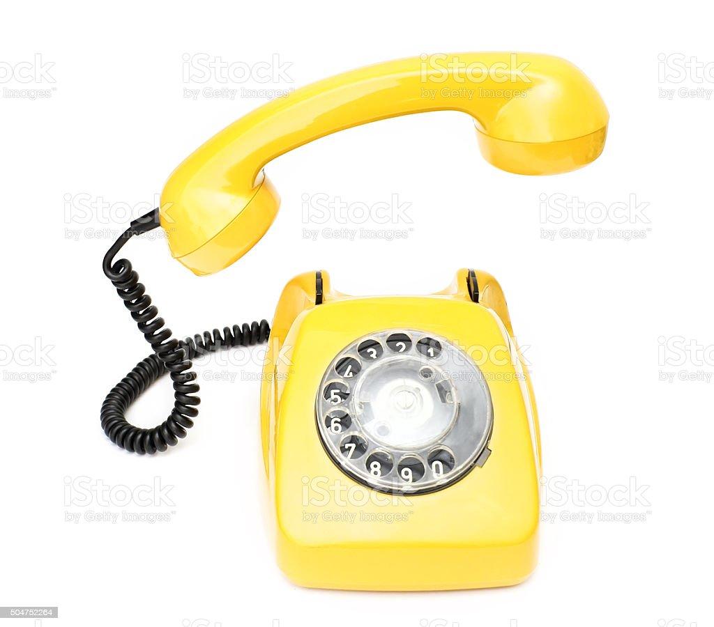 Yellow retro telephone isolated on white background. stock photo