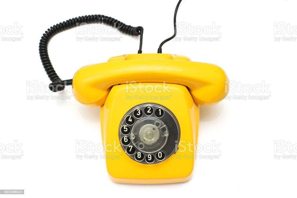 Yellow retro telephone isolated on white background - Royalty-free Above Stock Photo