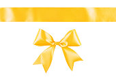 istock Yellow ribbon bow isolated on white background 1125208053