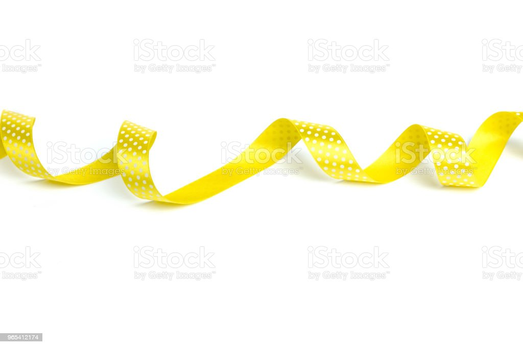 Yellow ribbons isolated on white royalty-free stock photo