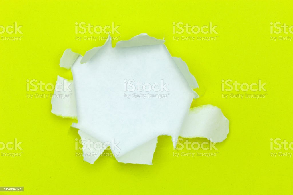 Yellow ripped open paper on white paper background. - Royalty-free Abstract Stock Photo