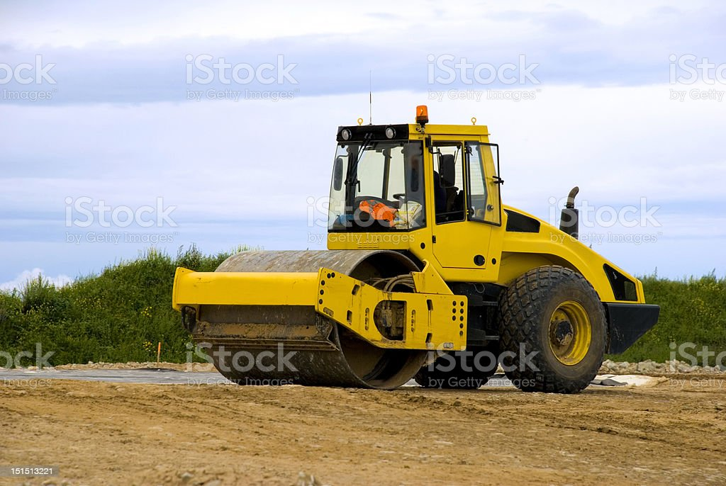 Yellow road roller at work royalty-free stock photo