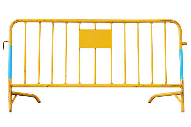 yellow road security barrier isolated on white background - barricata foto e immagini stock