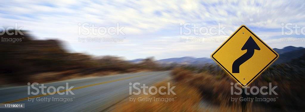 A yellow road sign indicating a curvy road royalty-free stock photo
