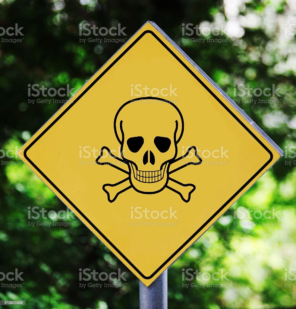 Yellow road sign outdoor with skull pictogram stock photo