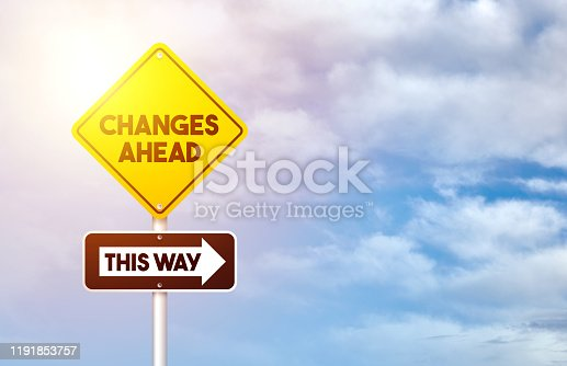 Yellow Road Traffic Sign with Change Ahead And This Way Text on Blue Sky