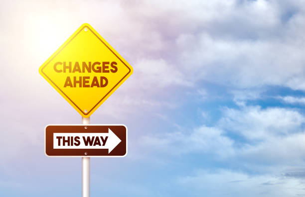 Yellow Road Traffic Sign with Change Ahead And This Way Text stock photo