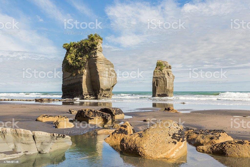 Yellow rocks on a seashore stock photo