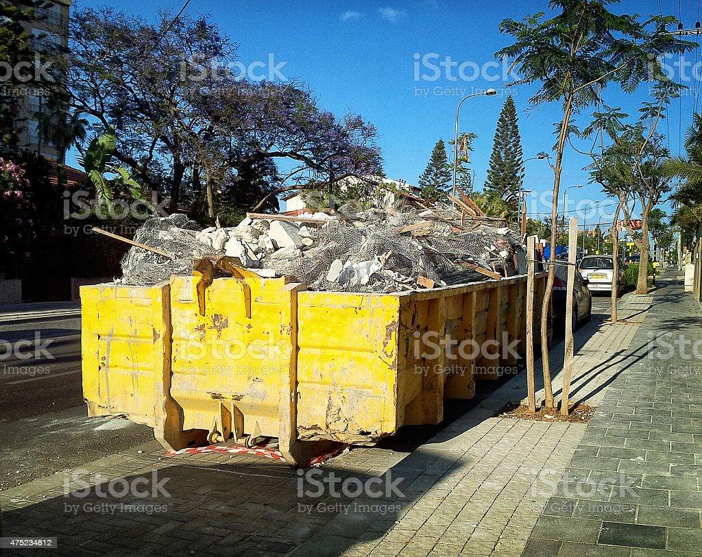 Yellow rolloff container stock photo