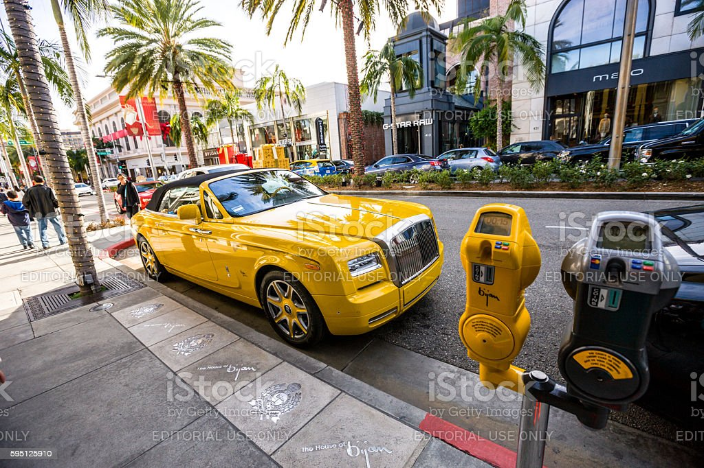 Yellow Rolls Royce Parked On Rodeo Drive Beverly Hills Stock Photo