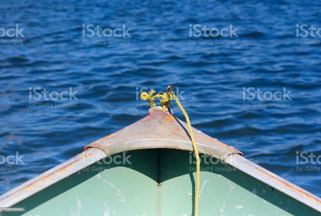 yellow rope in front of a shallop on a lake stock photo