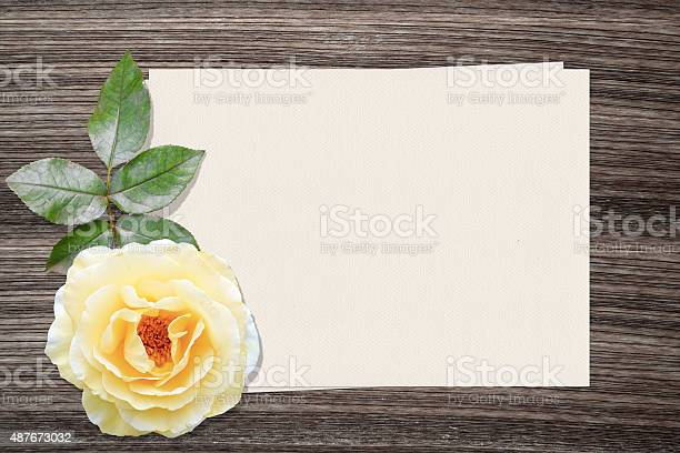 Yellow rose and and paper on wood background picture id487673032?b=1&k=6&m=487673032&s=612x612&h=bjrrkxdfb3wnip1axygtywkqxfiduodotdzcxlsanz8=