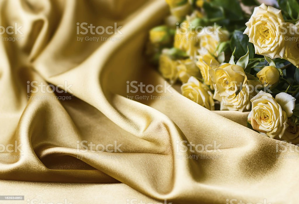 Yellow roses on silk background royalty-free stock photo