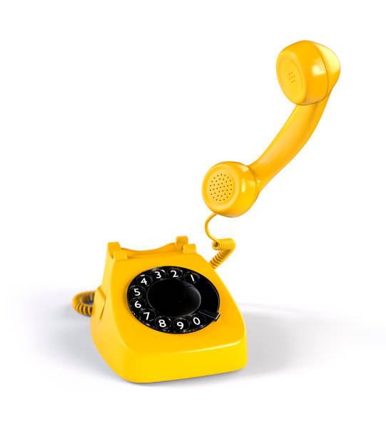 Yellow Rotary Phone stock photo