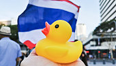 istock Yellow rubber duck represents a symbol of innocent people in the peaceful rally at King George Square, City Hall, in Brisbane Australia to protest the dictatorship of the prime minister Prayuth Chan-ocha in Thailand and also protest to bring Thai Monarchy 1299447335