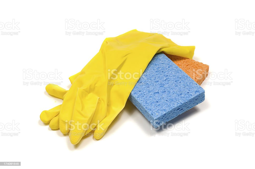 Yellow rubber gloves and sponges stock photo