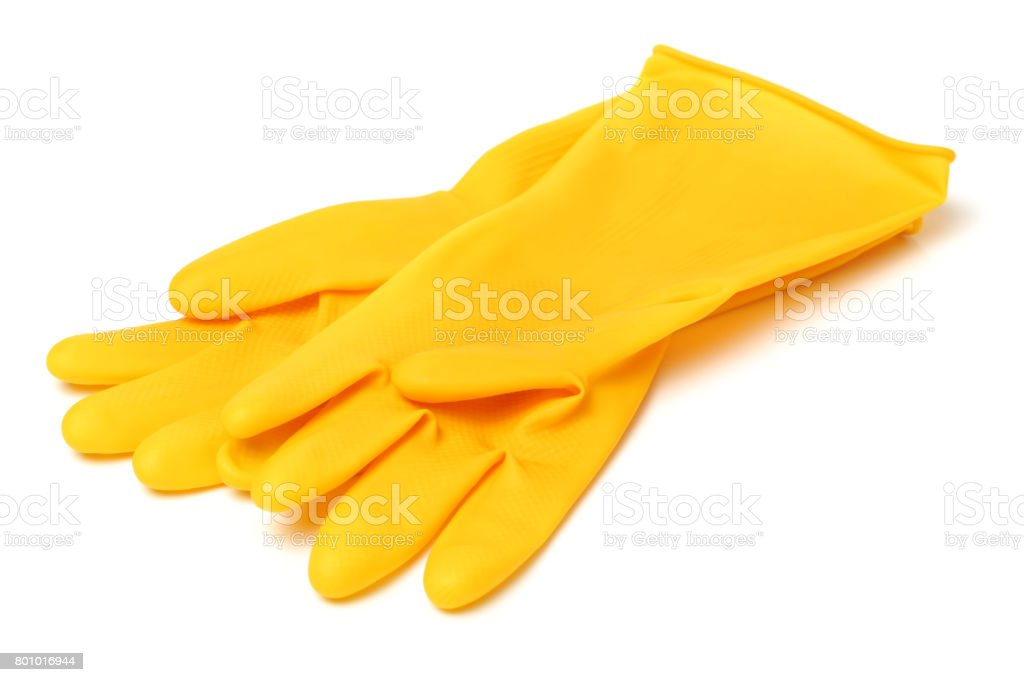 Yellow rubber gloves on white background stock photo