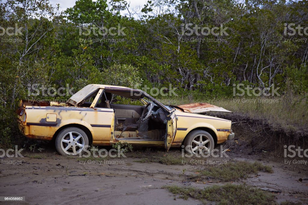 Yellow Rusted Wreck Of A Car Abandoned In The mud - Royalty-free Abandoned Stock Photo