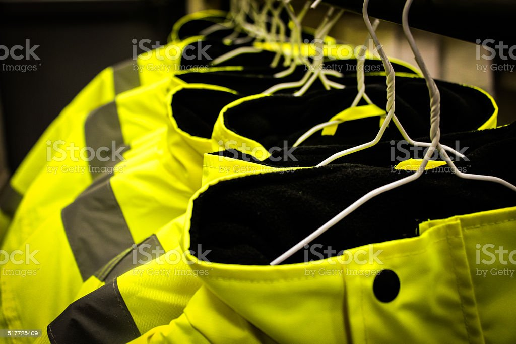 Yellow safety fluorescent jackets Hanged up stock photo