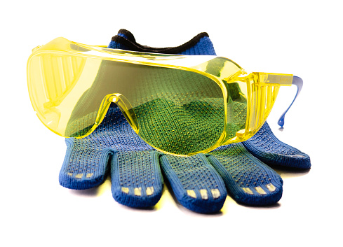 yellow safety glasses and gloves isolated on white background