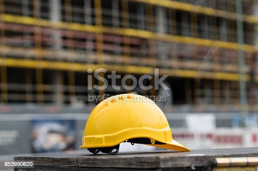 istock Yellow safety hardhat. Side view 853990620