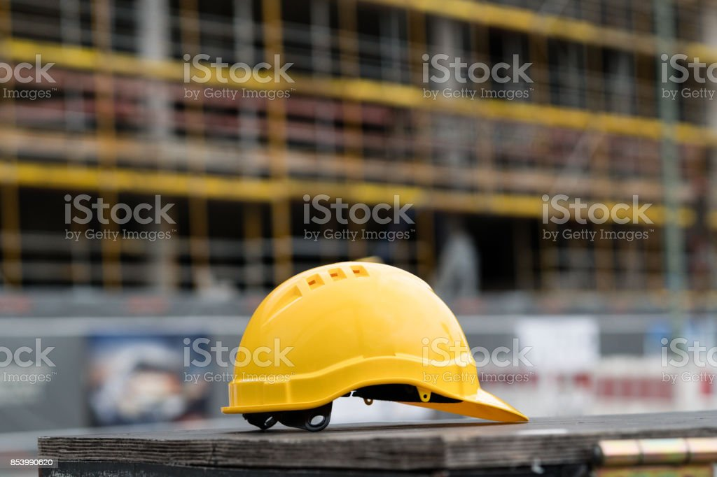 Yellow safety hardhat. Side view stock photo