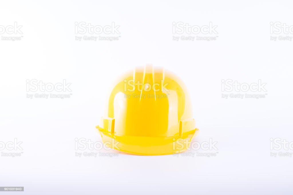 Yellow safety helmet on white background. Hard hat isolated on white. Safety equipment concept. Worker and Industrial theme. stock photo