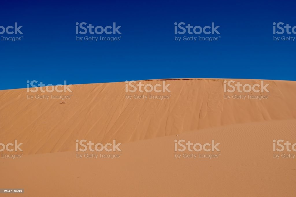 Yellow sand and blue sky. stock photo