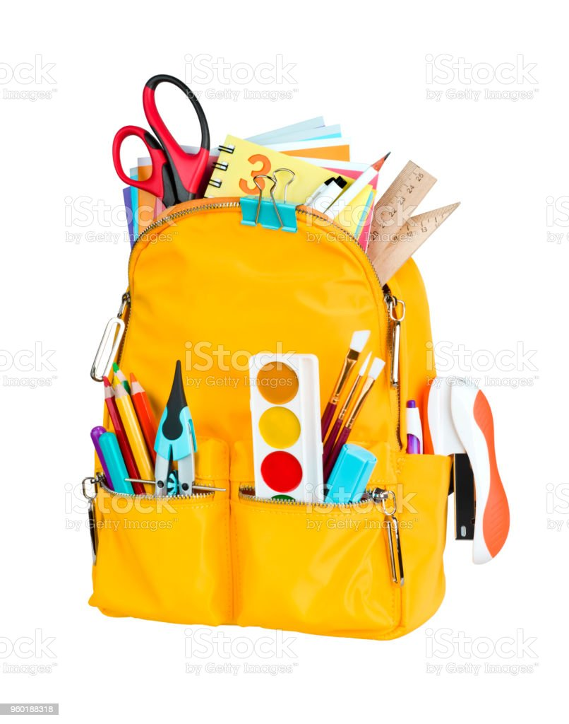 Yellow school backpack with school supplies isolated on white background royalty-free stock photo