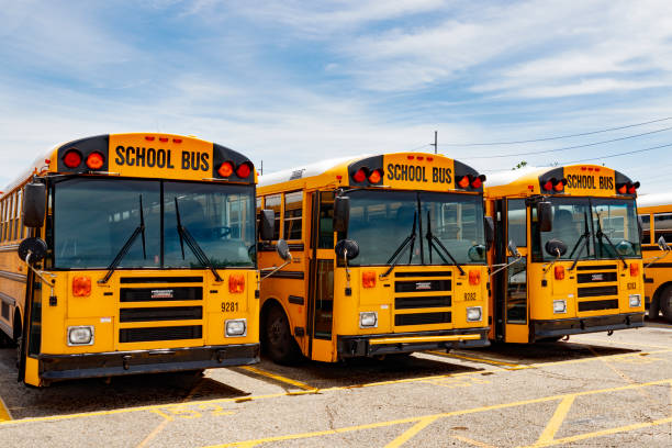 Yellow School Bus in a District Lot Waiting to Depart for Students V stock photo