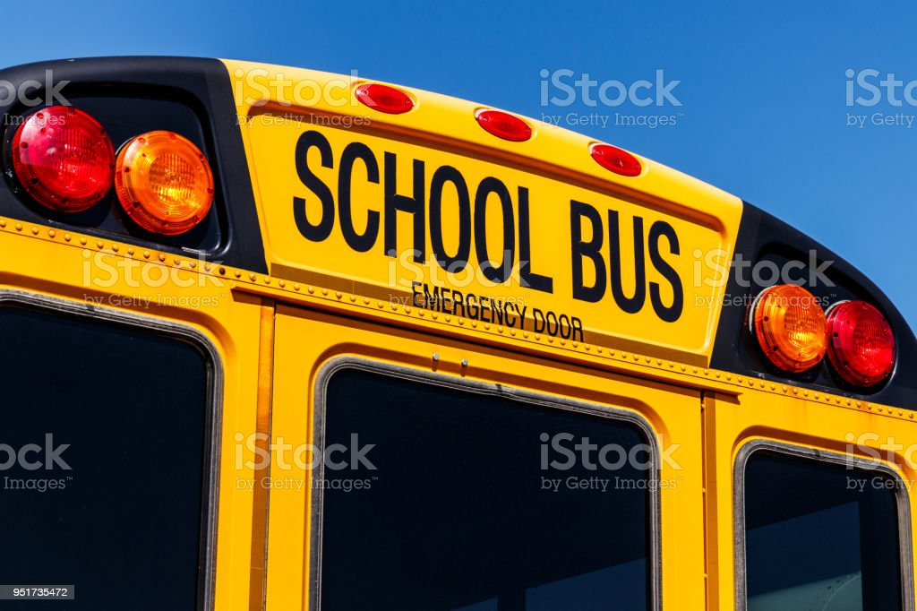 Yellow School Bus in a District Lot Waiting to Depart for Students VI stock photo