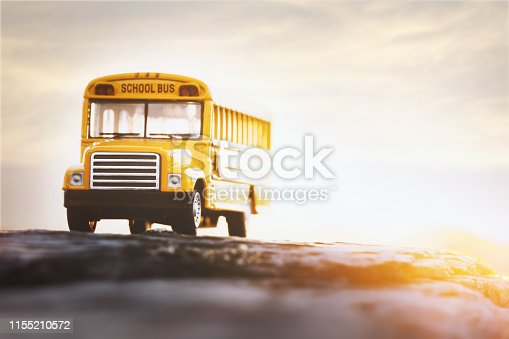 Yellow school bus toy model.Back to school /Education concept background.