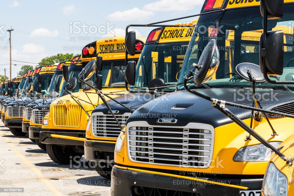 Yellow School Buses in a District Lot Waiting to Depart for Students IV stock photo