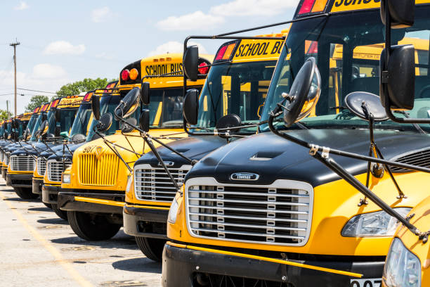 Yellow School Buses in a District Lot Waiting to Depart for Students IV Cincinnati - Circa May 2017: Yellow School Buses in a District Lot Waiting to Depart for Students IV depart stock pictures, royalty-free photos & images