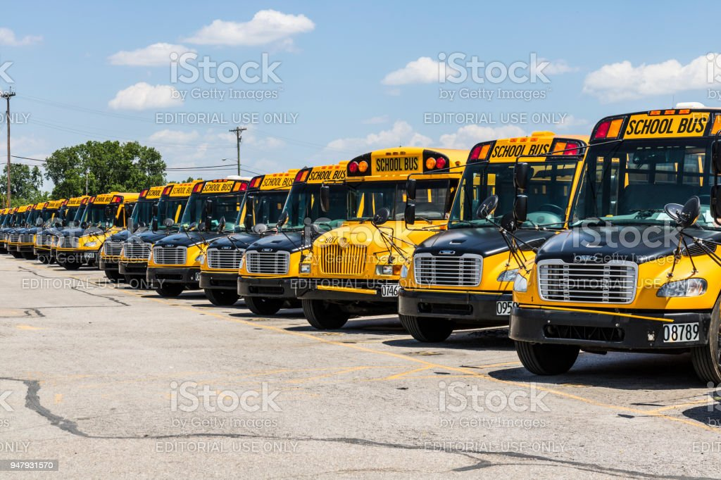Yellow School Buses in a District Lot Waiting to Depart for Students V stock photo