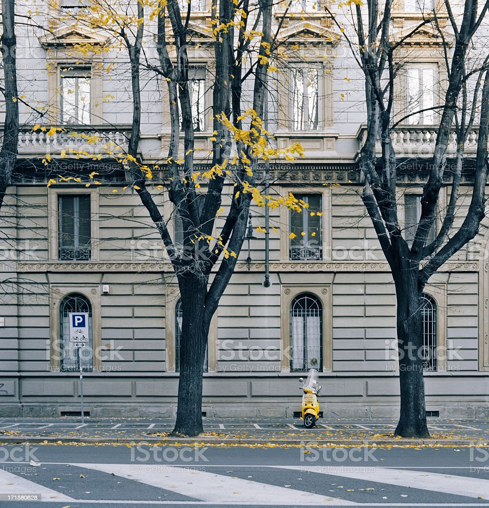 Yellow scooter parked in Milan, Italy stock photo