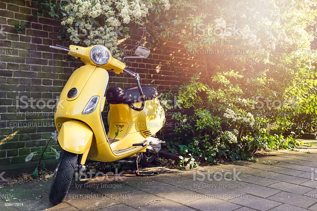 Yellow scooter parked stock photo