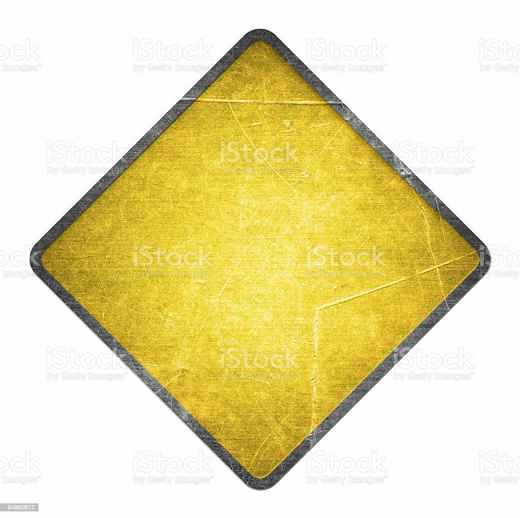 Yellow scratched road sign stock photo