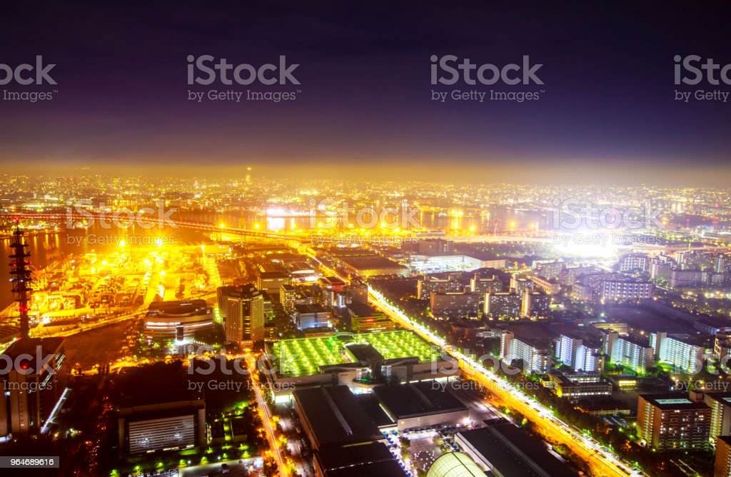 yellow sea and horizon and town and factory royalty-free stock photo