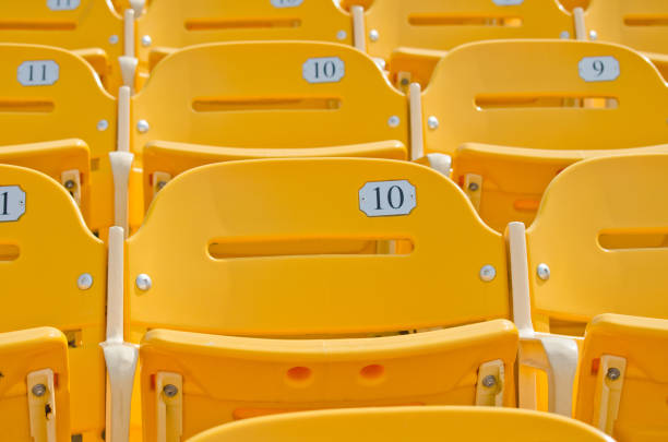yellow  seats - sports event stock photos and pictures