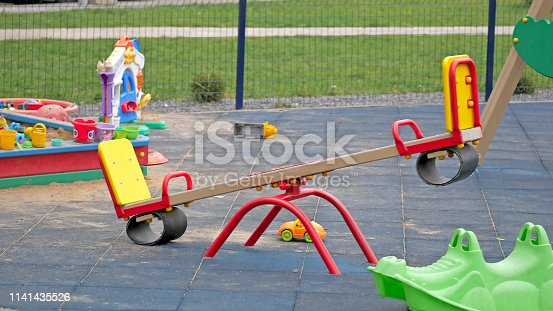Yellow Seesaw In The Playground