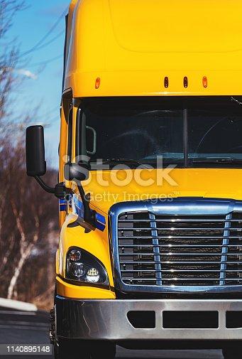 A bright yellow semi truck.