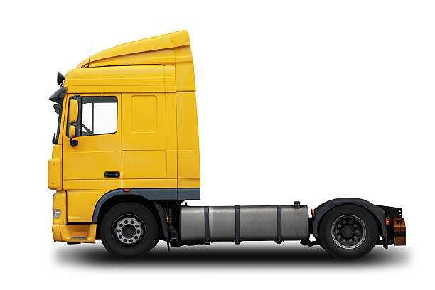 Yellow semi truck with a white background stock photo