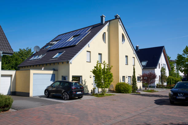 Yellow semidetached house with solar panels on the roof stock photo