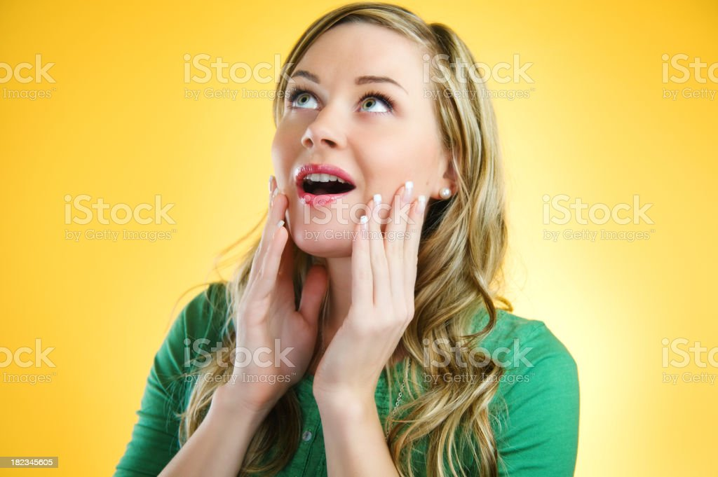 Yellow series - Amazed woman royalty-free stock photo